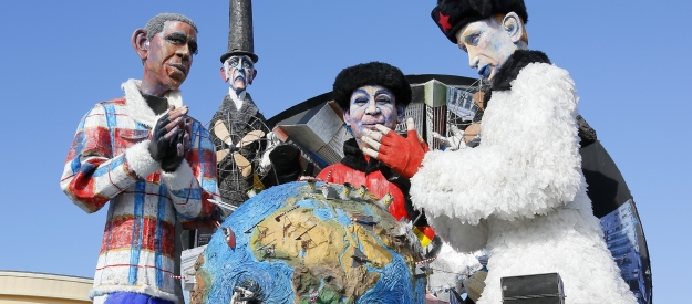 "A float depicting United States President Barack Obama, left, Chinese President Xi Jinping, center, and Russian President Vladimir Putin and entitled ""The Big Cold""  is shown at the traditional Viareggio Carnival parade in Viareggio, Italy, Sunday, Feb. 1, 2015. (AP Photo/Fabio Muzzi)"